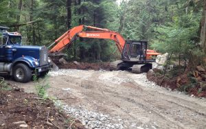 large excavator working on an access road