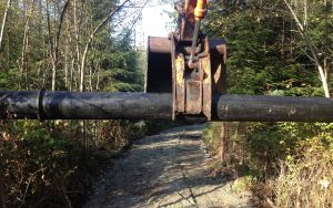 drainage pipe lifted by an excavator