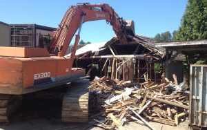 ex200 excavator demo on an old house