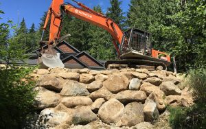 beautiful rock wall and excavator