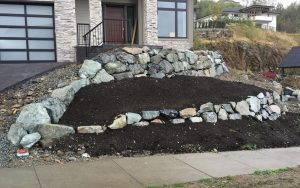 landscaped rock wall at front of house